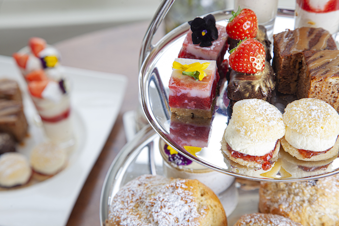 A tower of sweet cakes and sandwiches - afternoon tea at Cotswold House.