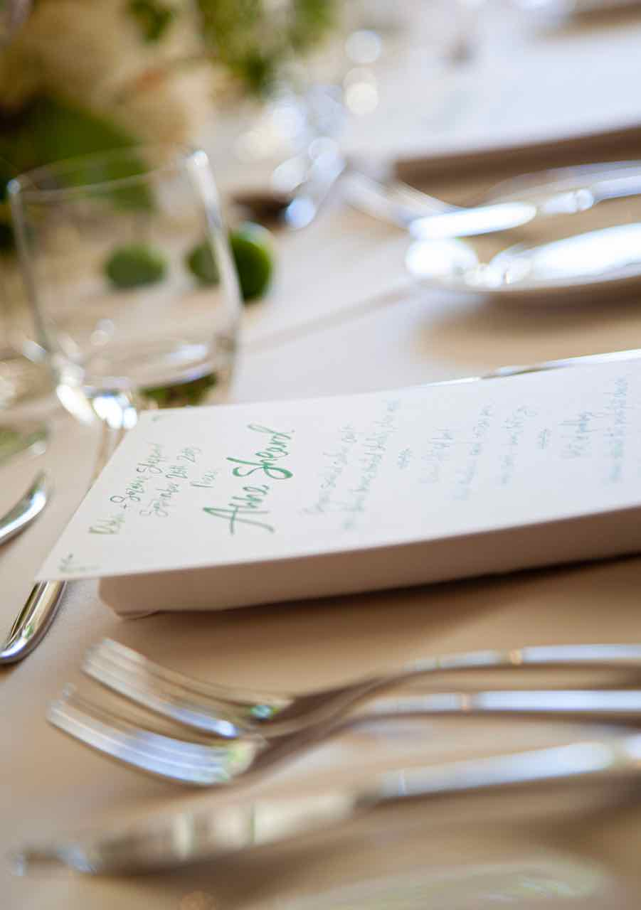 Wedding table set-up with menu and cutlery.